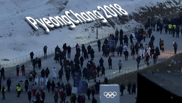 <p>People arrive at the Olympic Stadium ahead of the opening ceremony at the 2018 Winter Olympics in Pyeongchang, South Korea, Friday, Feb. 9, 2018. (AP Photo/Kirsty Wigglesworth) </p>