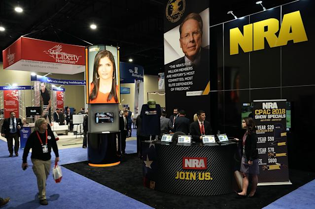 <p>The booth of National Rifle Association (NRA) is seen during CPAC 2018, Feb. 22, 2018 in National Harbor, Md. (Photo: Alex Wong/Getty Images) </p>