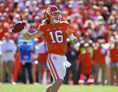 Clemson's Trevor Lawrence drops back to pass during the first half of an NCAA college football game against Louisville, Saturday, Nov. 3, 2018, in Clemson, S.C. (AP Photo/Richard Shiro)