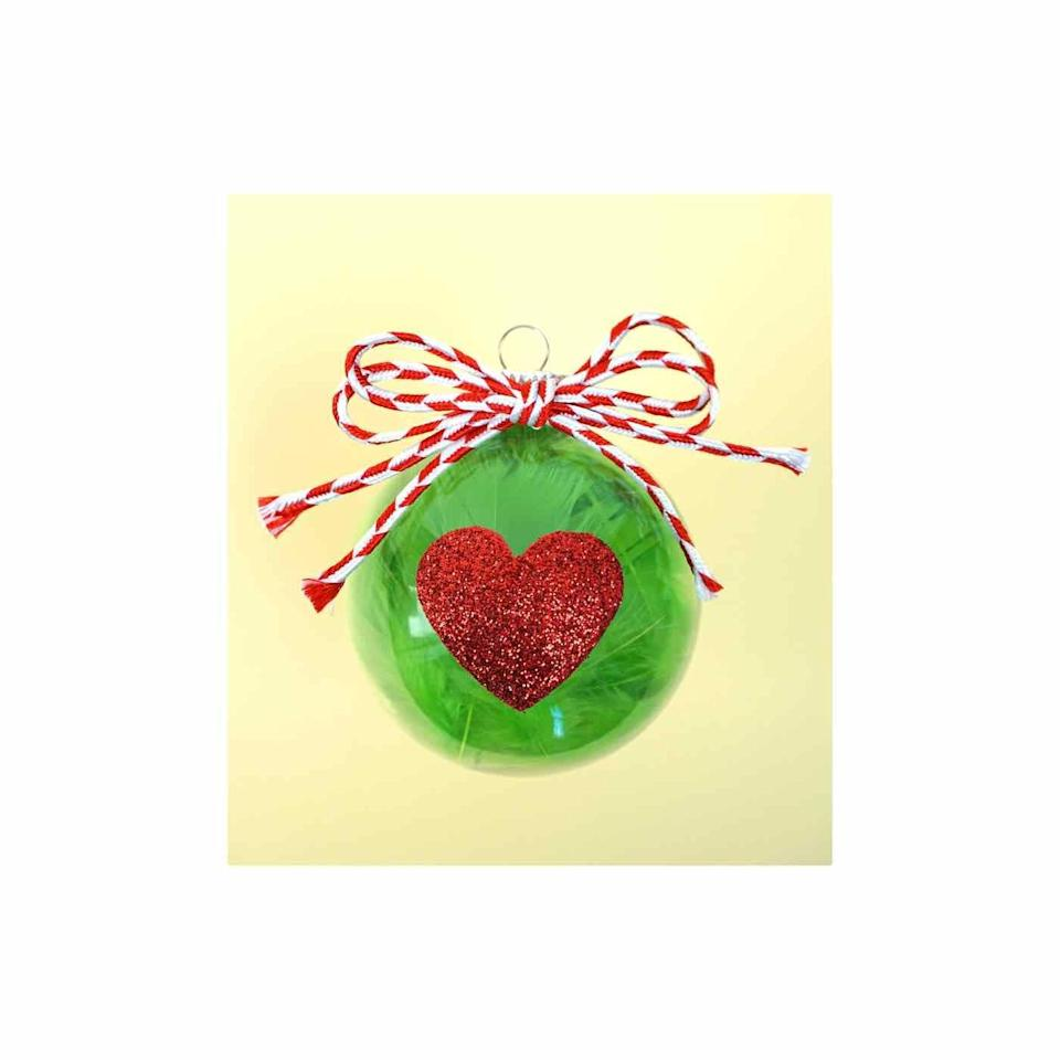 """<p>Your heart will grow at least two sizes watching how much fun your kids have assembling this glittered movie-themed ornament. </p><p><em>Get the tutorial at <a href=""""https://www.happinessishomemade.net/christmas-kids-craft-grinch-ornaments/"""" rel=""""nofollow noopener"""" target=""""_blank"""" data-ylk=""""slk:Happiness Is Homemade"""" class=""""link rapid-noclick-resp"""">Happiness Is Homemade</a>.</em></p><p><a class=""""link rapid-noclick-resp"""" href=""""https://www.amazon.com/Emerald-Kelly-Green-Tissue-Paper/dp/B07PRZ9W1L/?tag=syn-yahoo-20&ascsubtag=%5Bartid%7C10072.g.34443405%5Bsrc%7Cyahoo-us"""" rel=""""nofollow noopener"""" target=""""_blank"""" data-ylk=""""slk:SHOP GREEN TISSUE PAPER"""">SHOP GREEN TISSUE PAPER</a></p>"""
