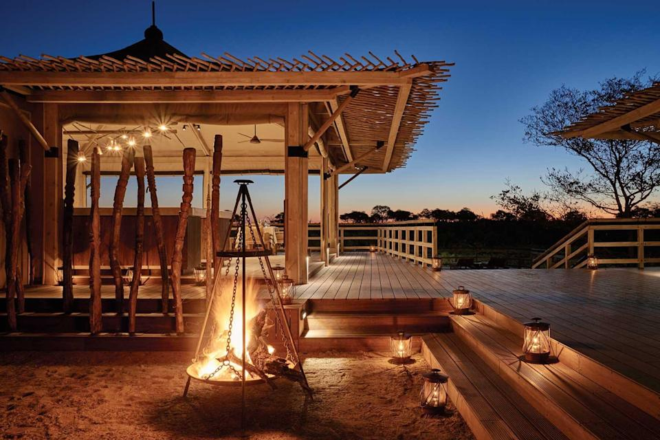 A fire-lit terrace at Belmond Savute Elephant Lodge, voted one of the best hotels in the world