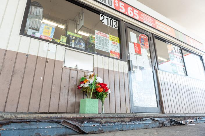 Flowers outside convenience store on Evangeline Thruway as a memorial to man shot and killed by Lafayette Police. Saturday, Aug. 22, 2020.