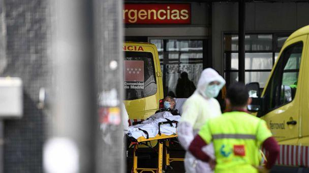PHOTO: A man wearing a face mask is wheeled into La Paz hospital in Madrid, March 23, 2020, amid a national lockdown to fight the spread of the coronavirus.  (Pierre-philippe Marcou/AFP/Getty Images)