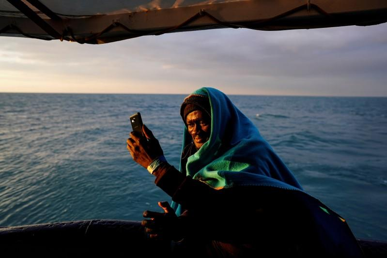Migrant takes a selfie on board of NGO Proactiva Open Arms rescue boat in the central Mediterranean Sea at the Italian port of Taranto