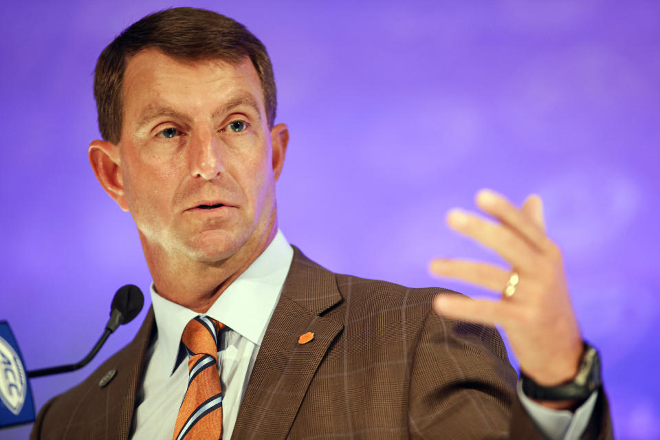 FILE - In this July 22, 2021, file photo, Clemson head coach Dabo Swinney answers a question during an NCAA college football news conference at the Atlantic Coast Conference media days in Charlotte, N.C. Atlantic Coast Conference coaches are counting on high program vaccination rates to minimize risks of illnesses or lineup-depleting contact tracing for the upcoming season. That's meant teams working through the offseason's final weeks toward an 85% threshold of vaccinated players, coaches and staffers. (AP Photo/Nell Redmond, File)