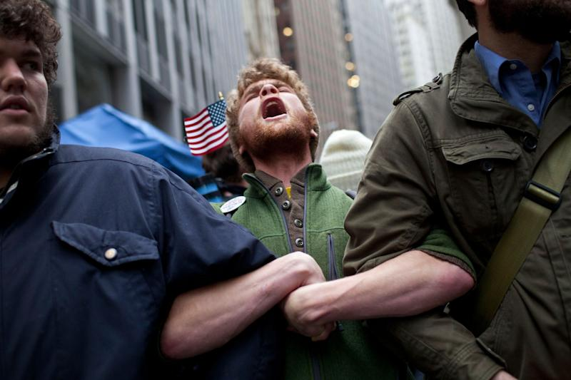 Protesters affiliated with the Occupy Wall Street movement lock arms at the intersection of Exchange Place and Beaver Street in the Financial District on Nov.17, 2011 in New York City. (Photo: Andrew Burton/Getty Images)