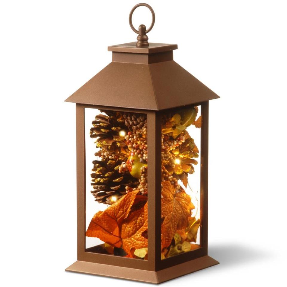 lantern with pinecones and leaves, fall decoration tips