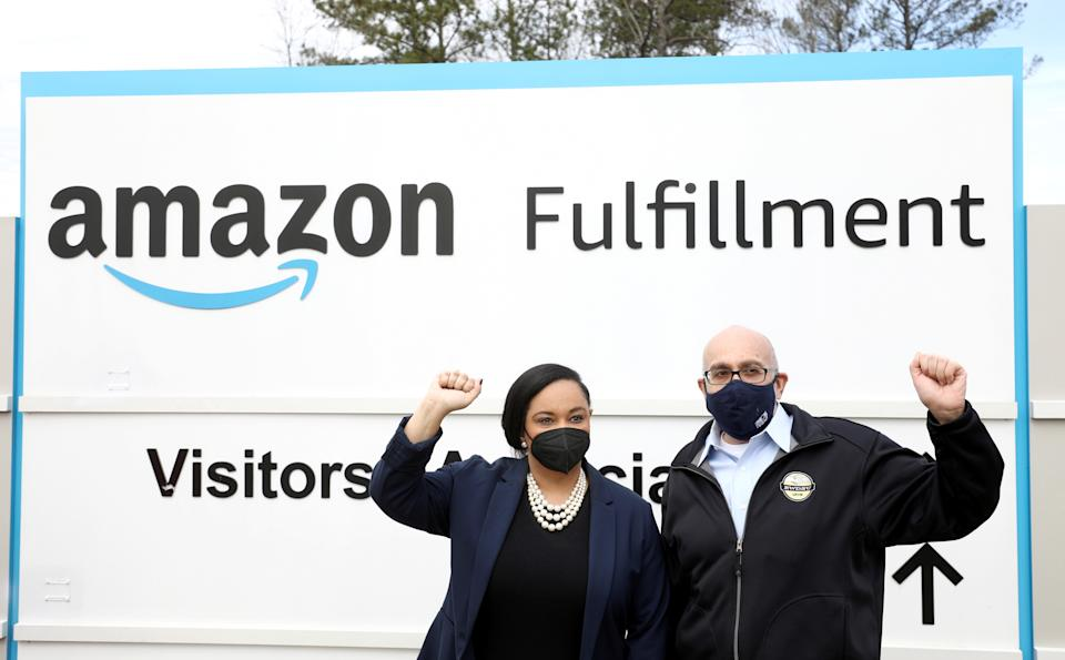 U.S. Rep. Nikema Williams and RWDSU President Stuart Appelbaum pose for a picture at the entrance to Amazon facility as they arrive as members of a congressional delegation to show their support for workers who will vote on whether to unionize, in Bessemer, Alabama, U.S. March 5, 2021.  REUTERS/Dustin Chambers REFILE - CORRECTING CITY