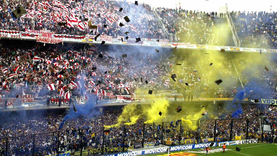 Boca Juniors and River Plate's fans chee   STR/Getty Images