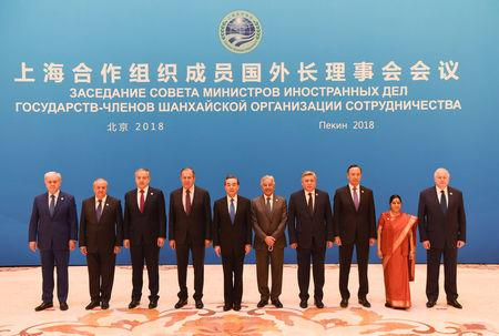Foreign ministers and officials of the Shanghai Cooperation Organisation (SCO) pose for a group photo before a meeting at the Diaoyutai State Guest House in Beijing, China, April 24, 2018. From left: SCO Secretary-General Rashid Alimov, Uzbek Foreign Minister Abdulaziz Kamilov, Tajik Foreign Minister Sirojidin Aslov, Russian Foreign Minister Sergei Lavrov, Chinese State Councilor and Foreign Minister Wang Yi, Pakistan Foreign Minister Khawaja Muhammad Asif, Kyrgyz Foreign Minister Erlan Abdyldaev, Kazakh Foreign Minister Kairat Abdrakhmanov, Indian Foreign Minister Sushma Swaraj, SCO Regional Anti-Terrorist Structure Director Yevgeniy Sergeyevich Sysoyev. MADOKA IKEGAMI/Pool via REUTERS