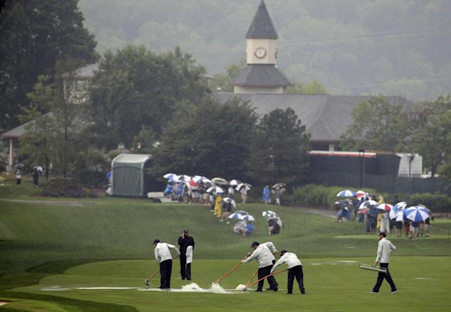 Members of the grounds crew push water off the 10th fairway during the second round of the PGA Championship golf tournament at Valhalla Golf Club on Friday, Aug. 8, 2014, in Louisville, Ky. (AP Photo/David J. Phillip)