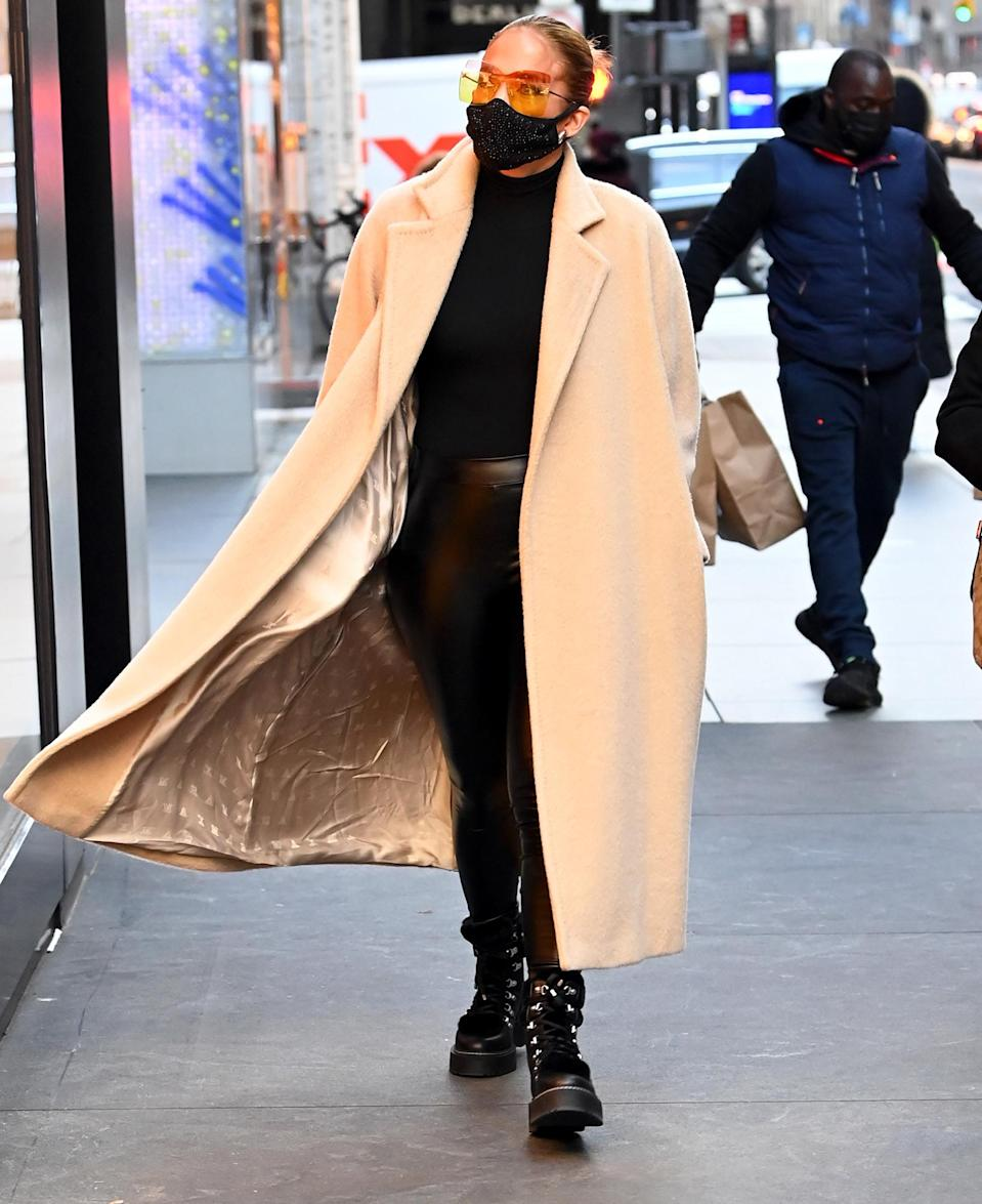 <p>Jennifer Lopez goes Christmas shopping and makes stops at Chanel and Christian Dior on N.Y.C.'s Madison Avenue on Monday.</p>