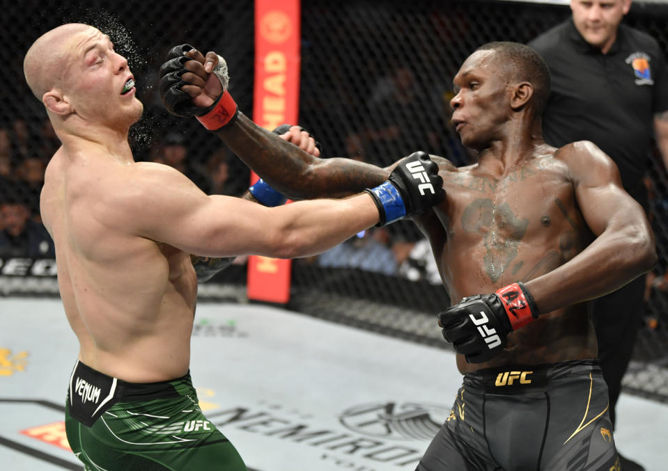 GLENDALE, ARIZONA - JUNE 12: Israel Adesanya of Nigeria punches Marvin Vettori of Italy in their UFC middleweight championship fight during the UFC 263 event at Gila River Arena on June 12, 2021 in Glendale, Arizona. (Photo by Jeff Bottari/Zuffa LLC)