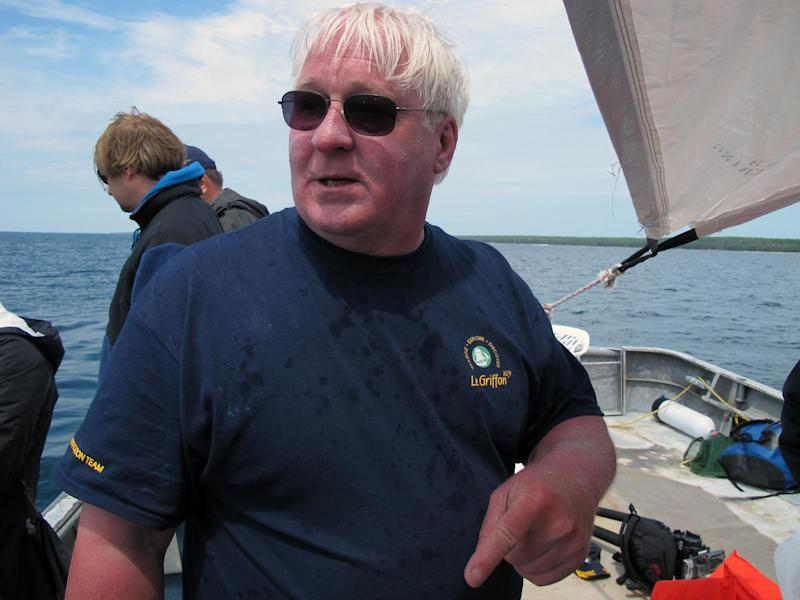 Steve Libert, head of the expedition seeking the explorer La Salle's lost ship the Griffin, stands on a fishing boat as dive teams prepare to inspect a site Saturday, June 15, 2013, in northern Lake Michigan where he believes the vessel may have sunk. Divers began opening an underwater pit Saturday at a remote site in northern Lake Michigan that they say could be the resting place of the Griffin, a ship commanded by the 17th century French explorer La Salle. (AP Photo/John Flesher)