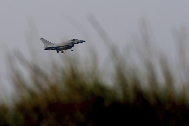 <p>A Typhoon aircraft prepares for landing at British Royal Air Forces base in Akrotiri, near costal city of Limassol in the eastern Mediterranean island of Cyprus, early Saturday, April 14, 2018. (Photo: Petros Karadjias/AP) </p>