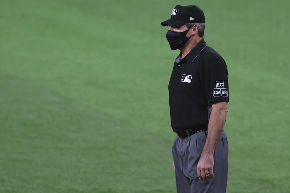 ARLINGTON, TEXAS - OCTOBER 06: Umpire Angel Hernandez #5 looks on from first base during Game One of the National League Divisional Series between the San Diego Padres and the Los Angeles Dodgers at Globe Life Field on October 06, 2020 in Arlington, Texas. (Photo by Tom Pennington/Getty Images)