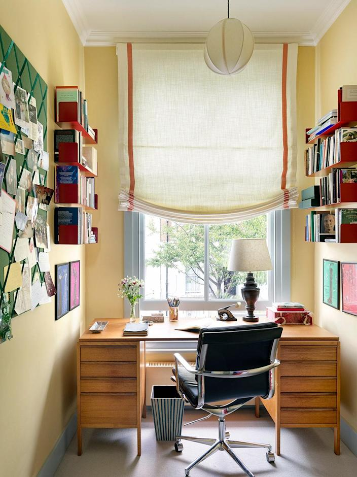 The counterpart's study is light and airy, including a vintage desk, a Beata Heuman Mini Globe pendant, and Farrow & Ball Hay paint.