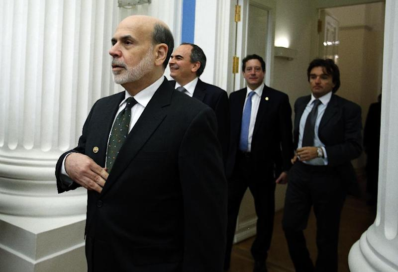 Ben Bernanke, chairman of the U.S. Federal Reserve, foreground left, enters a hall to attend the summit of financial ministers and heads of central banks of the G20 group of nations ahead of their key meeting this weekend in Moscow, Russia, Friday, Feb. 15, 2013. Russia's President Vladimir Putin has called on financial chiefs of the world's leading industrial and developing nations to consider political and social implications of the crucial policy steps they take. (AP Photo/Alexander Zemlianichenko)