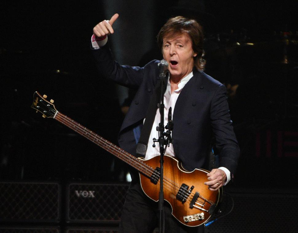 FILE - In this Oct. 22, 2015, file photo, Paul McCartney performs at First Niagara Center, in Buffalo, N.Y. Goldenvoice announced Tuesday, May 3, 2016, that the Rolling Stones, Bob Dylan, McCartney, Neil Young, Roger Waters and the Who will perform during a three-day concert at the desert grounds where the annual Coachella music festival is held. (AP Photo/Gary Wiepert, File)