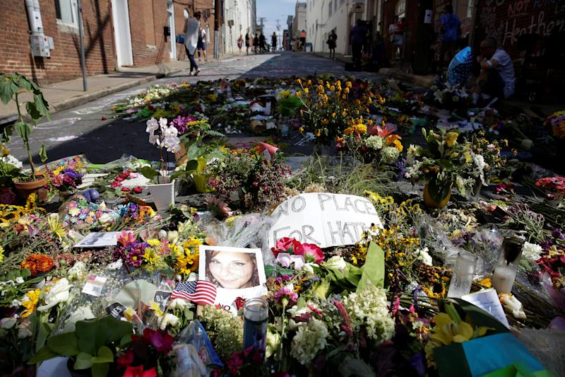 Flowers are seen on the street on Aug. 16, 2017, where Heather Heyer was killed when a suspected white nationalist plowed his car into a group of anti-racist demonstrators in Charlottesville, Va. (Photo: Joshua Roberts/Reuters)