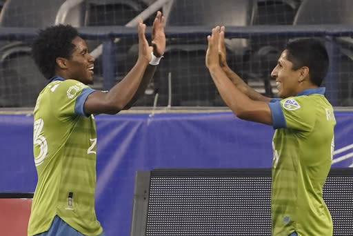 Seattle Sounders' Raul Ruidiaz, right, celebrates with Joevin Jones after Ruidiaz scored a goal against the San Jose Earthquakes during the first half of an MLS soccer match Thursday, Sept. 10, 2020, in Seattle. (AP Photo/Ted S. Warren)