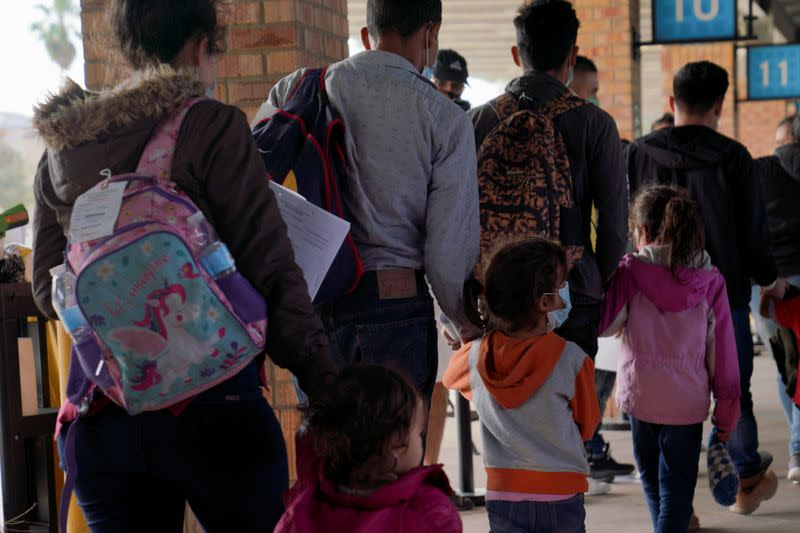 FILE PHOTO: Asylum seekers at the bus station in Brownsville, Texas