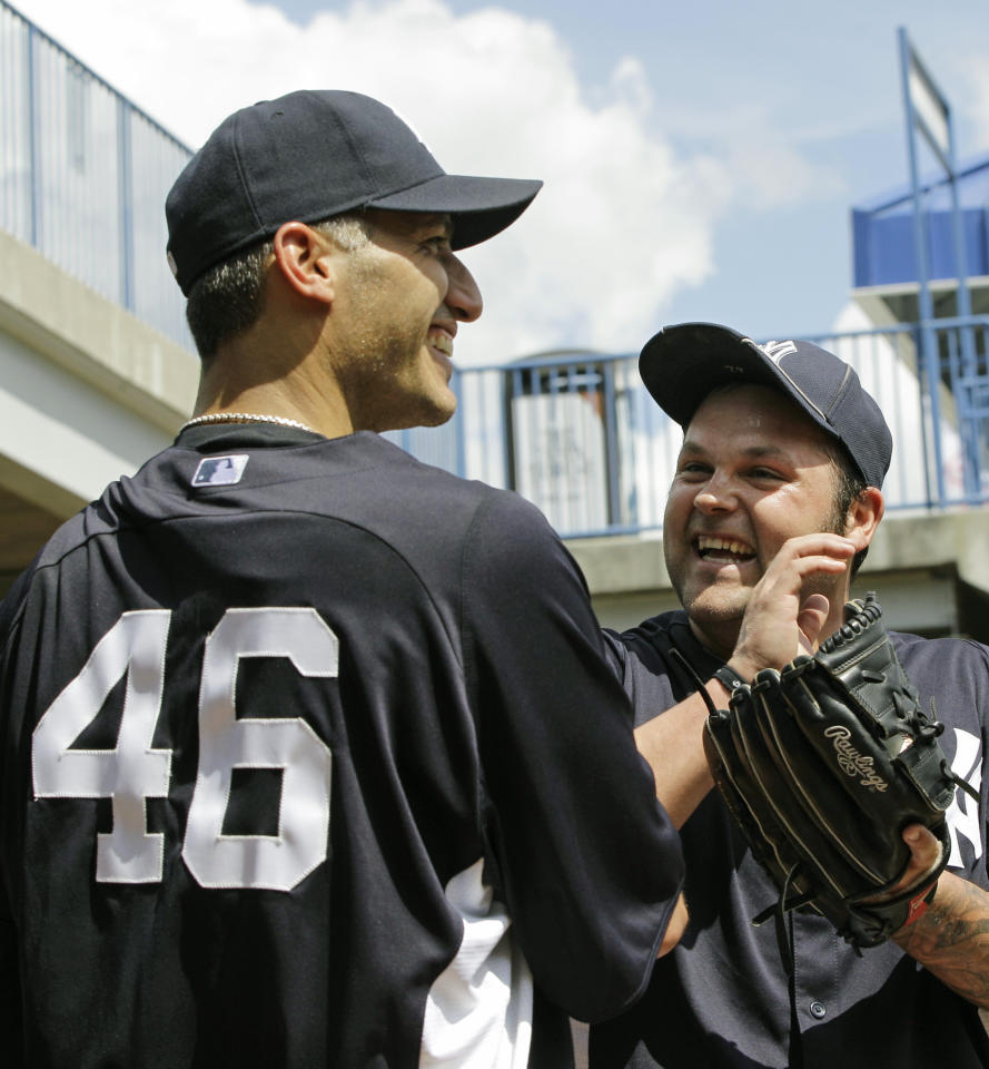 Andy Pettitte, (46), who came out of retirement on a minor league contract to pitch for his former team, jokes around with New York Yankees reliever Joba Chamberlain after throwing in the bullpen at the Yankees spring training facility at Steinbrenner Field in Tampa, Fla., Tuesday, March 20, 2012. Pettitte last pitched for the Yankees in 2009, helping them win the 2009 World Series. (AP Photo/Kathy Willens)