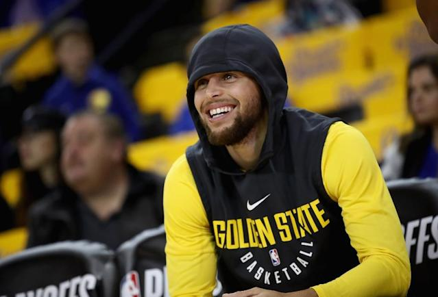 Stephen Curry of the Golden State Warriors, seen here sitting on the bench before a game against the San Antonio Spurs in Round 1 of the 2018 NBA Playoffs on April 16, 2018 in Oakland, California, could return from his injury absence soon (AFP Photo/EZRA SHAW)