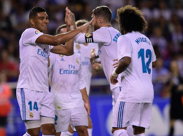 Real Madrid's midfielder Casemiro (L) celebrates with teammates after scoring on August 20, 2017