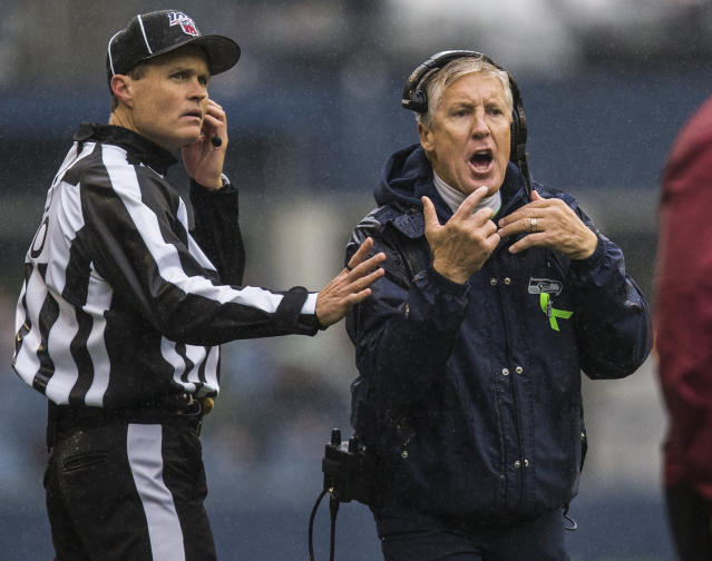 Seattle Seahawks head coach Pete Carroll, tight, yells at referees during an NFL football game against the Baltimore Ravens, Sunday, Oct. 20, 2019 in Seattle, Wash. (Olivia Vanni /The Herald via AP)