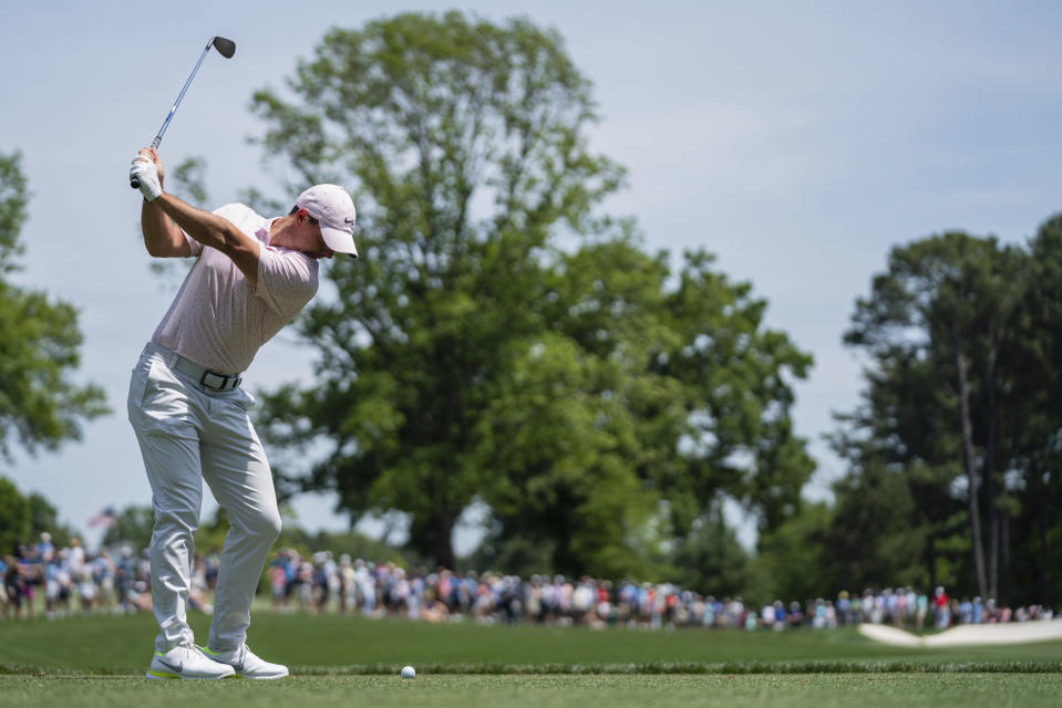 Rory McIlroy tees off on the fourth hole during the fourth round of the Wells Fargo Championship golf tournament at Quail Hollow on Sunday, May 9, 2021, in Charlotte, N.C. (AP Photo/Jacob Kupferman)