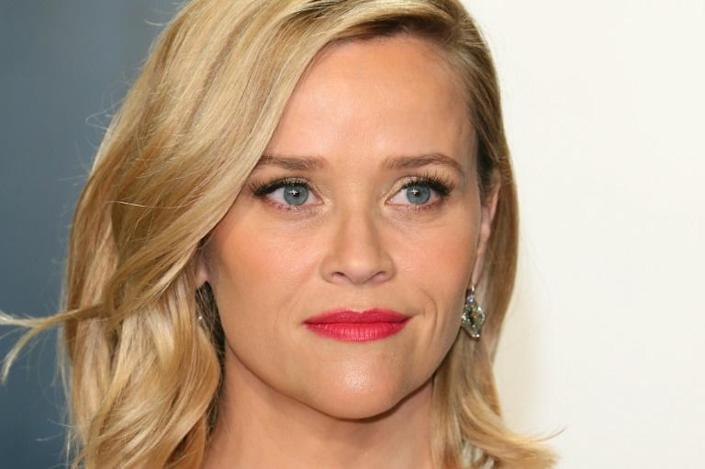 The hunt for images of US actress Reese Witherspoon continues to draw Los Angeles paparazzi out onto the streets (AFP Photo/Jean-Baptiste Lacroix)