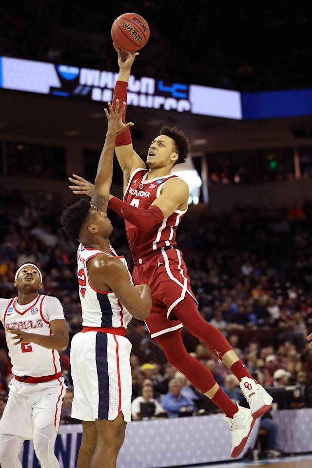 <p>Jamuni McNeace #4 of the Oklahoma Sooners shoots against Bruce Stevens #12 of the Mississippi Rebels in the first half during the first round of the 2019 NCAA Men's Basketball Tournament at Colonial Life Arena on March 22, 2019 in Columbia, South Carolina. (Photo by Streeter Lecka/Getty Images) </p>