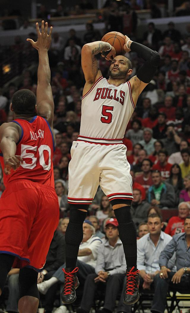 CHICAGO, IL - MAY 08: Carlos Boozer #5 of the Chicago Bulls shoots over Lavoy Allen #50 of the Philadelphia 76ers on his way to 19 points in Game Five of the Eastern Conference Quarterfinals during the 2012 NBA Playoffs at the United Center on May 8, 2012 in Chicago, Illinois. The Bulls defeated the 76ers 77-69. NOTE TO USER: User expressly acknowledges and agrees that, by downloading and or using this photograph, User is consenting to the terms and conditions of the Getty Images License Agreement. (Photo by Jonathan Daniel/Getty Images)