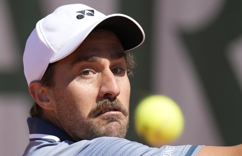 United States's Steve Johnson eyes the ball as he plays a return to United States's Frances Tiafoe during their first round match on day two of the French Open tennis tournament at Roland Garros in Paris, France, Monday, May 31, 2021. (AP Photo/Christophe Ena)