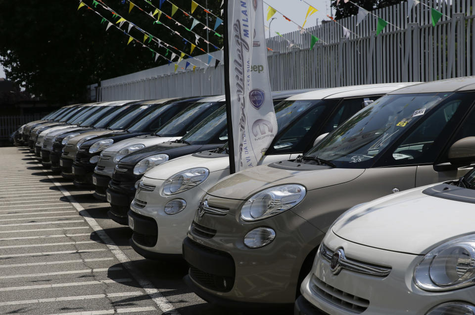 Cars are parked at a Fiat car dealer in Milan, Italy, Wednesday, July 25, 2018. Sergio Marchionne, a charismatic and demanding CEO who engineered two long-shot corporate turnarounds to save both Fiat and Chrysler from near-certain failure, died Wednesday. He was 66. The holding company of Italian automaker Fiat's founders, the Agnelli family, announced Marchionne had died after complications from surgery in Zurich. At Fiat Chrysler Automobiles headquarters in the Italian town of Turin, flags flew at half-mast, while in Rome the parliamentary committee for labor and finance observed a minute of silence. (AP Photo/Luca Bruno)
