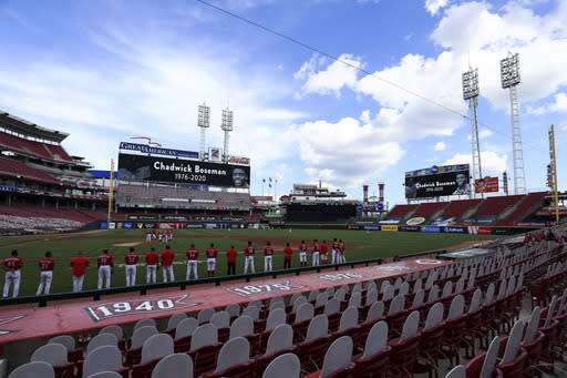 Videoboards pay tribute to Chadwick Boseman prior to a baseball game between the Chicago Cubs and the Cincinnati Reds in Cincinnati, Saturday, Aug. 29, 2020. (AP Photo/Aaron Doster)