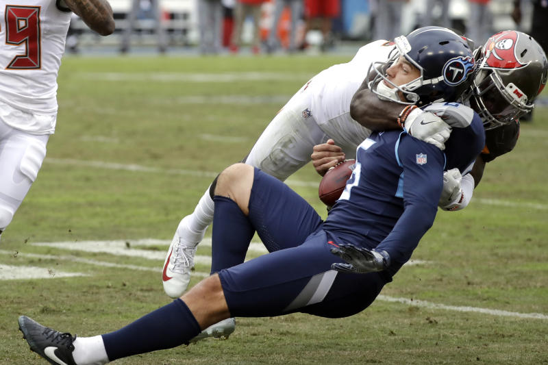 Tennessee Titans kick holder Brett Kern (6) is brought down by Tampa Bay Buccaneers linebacker Devin White on a fake field goal play in the second half of an NFL football game Sunday, Oct. 27, 2019, in Nashville, Tenn. (AP Photo/James Kenney)