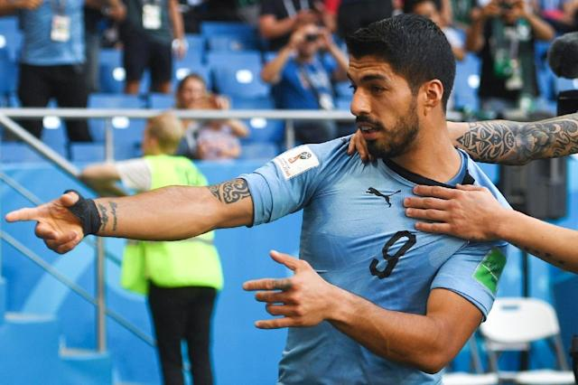 Off the mark: Suarez bagged his first goal of the tournament to send Uruguay into the last 16 (AFP Photo/Khaled DESOUKI)