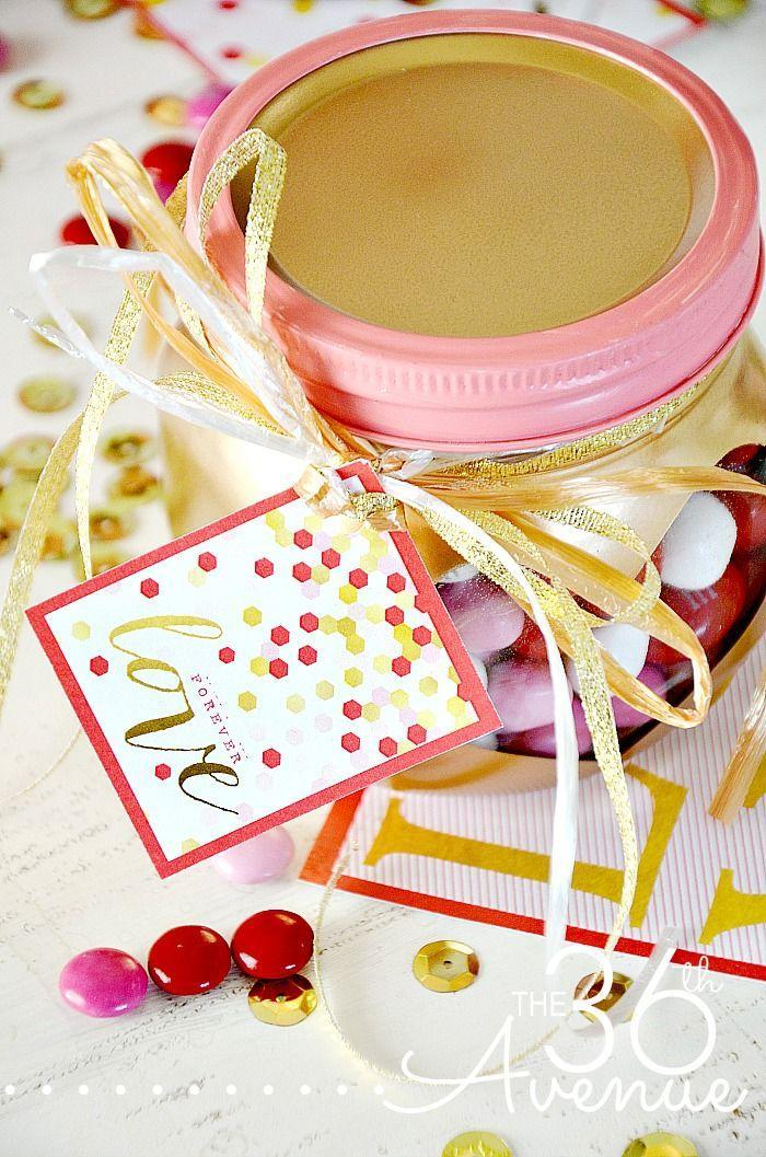"""<p>Fill these metallic jars with M&M's and gift to your neighbors or friends. </p><p><strong>Get the tutorial at <a href=""""http://www.the36thavenue.com/valentines-day-gift-heart-jars/"""" rel=""""nofollow noopener"""" target=""""_blank"""" data-ylk=""""slk:The 36th Avenue"""" class=""""link rapid-noclick-resp"""">The 36th Avenue</a>.</strong></p><p><a class=""""link rapid-noclick-resp"""" href=""""https://www.amazon.com/Encheng-Wedding-Canning-Kitchen-Storage/dp/B07PVLSRSZ/ref=sr_1_15?tag=syn-yahoo-20&ascsubtag=%5Bartid%7C10050.g.93%5Bsrc%7Cyahoo-us"""" rel=""""nofollow noopener"""" target=""""_blank"""" data-ylk=""""slk:SHOP MASON JARS"""">SHOP MASON JARS</a> </p>"""