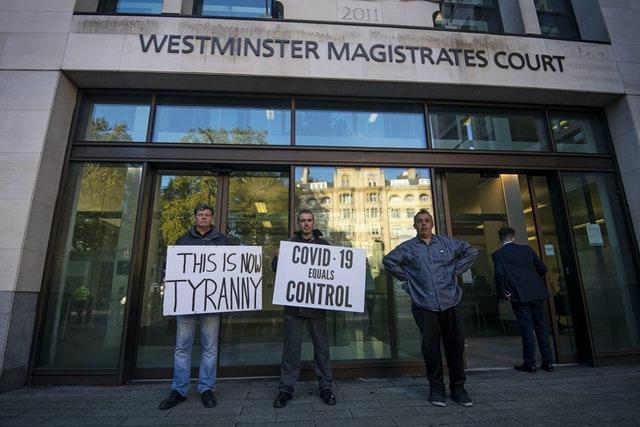 Anti-lockdown demonstrators outside Westminster Magistrates' Court (Victoria Jones/PA)