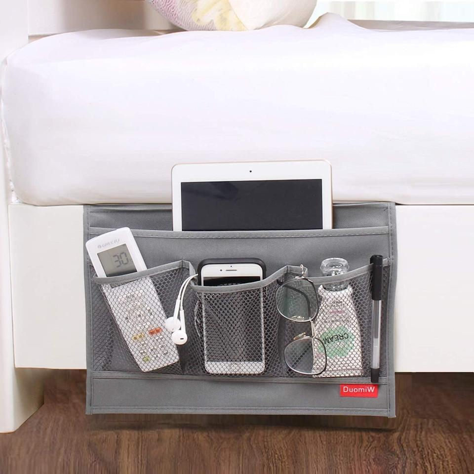 <p>Make their bedtime routine a little easier with the <span>DuomiW Bedside Storage Organizer</span> ($6, originally $7).</p>