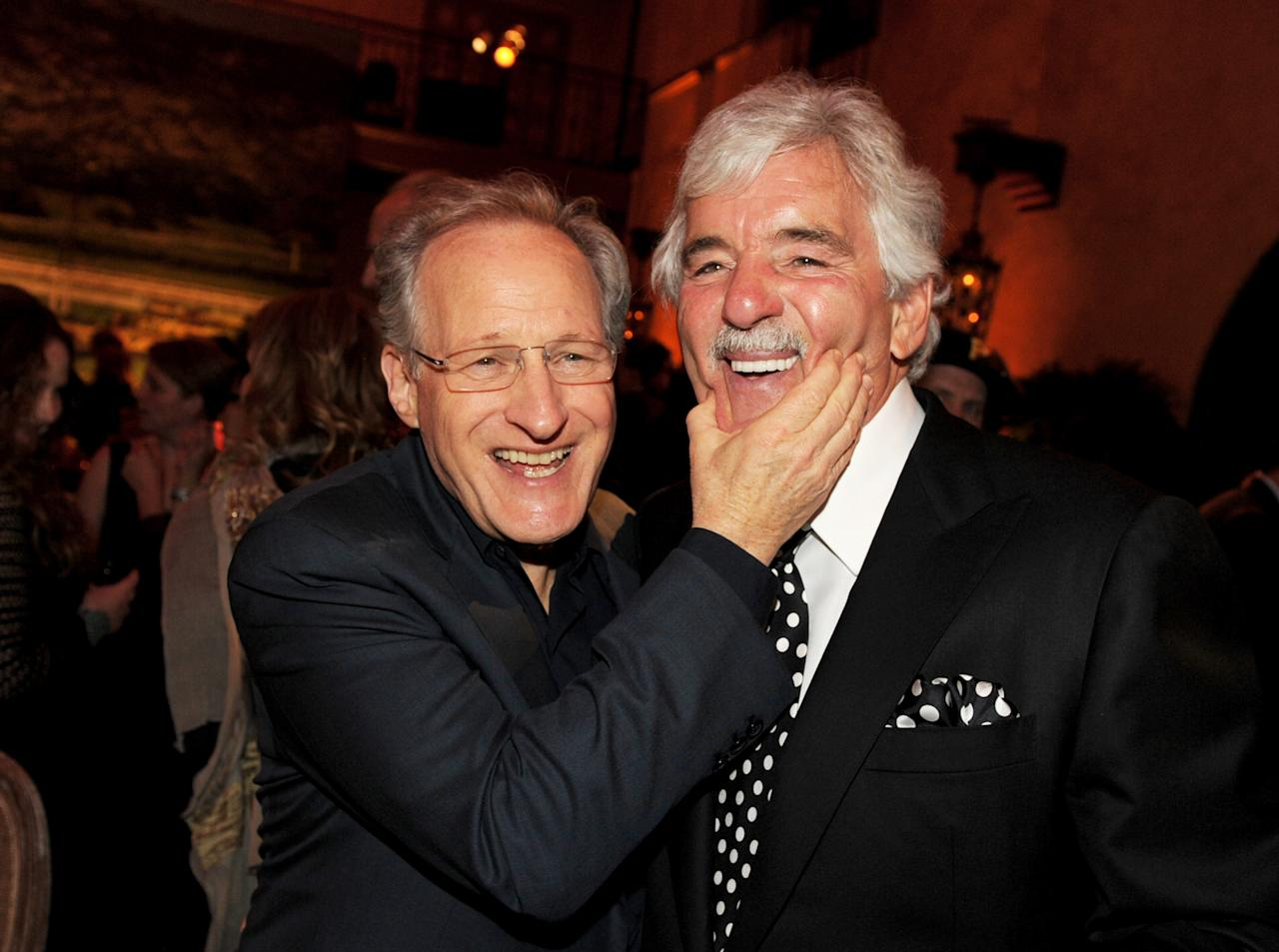 """LOS ANGELES, CA - JANUARY 25:  Executive producer/director Michael Mann (L) and actor Dennis Farina pose at the after party for the premiere of HBO's """"Luck"""" at the Roosevelt Hotel on January 25, 2012 in Los Angeles, California.  (Photo by Kevin Winter/Getty Images)"""