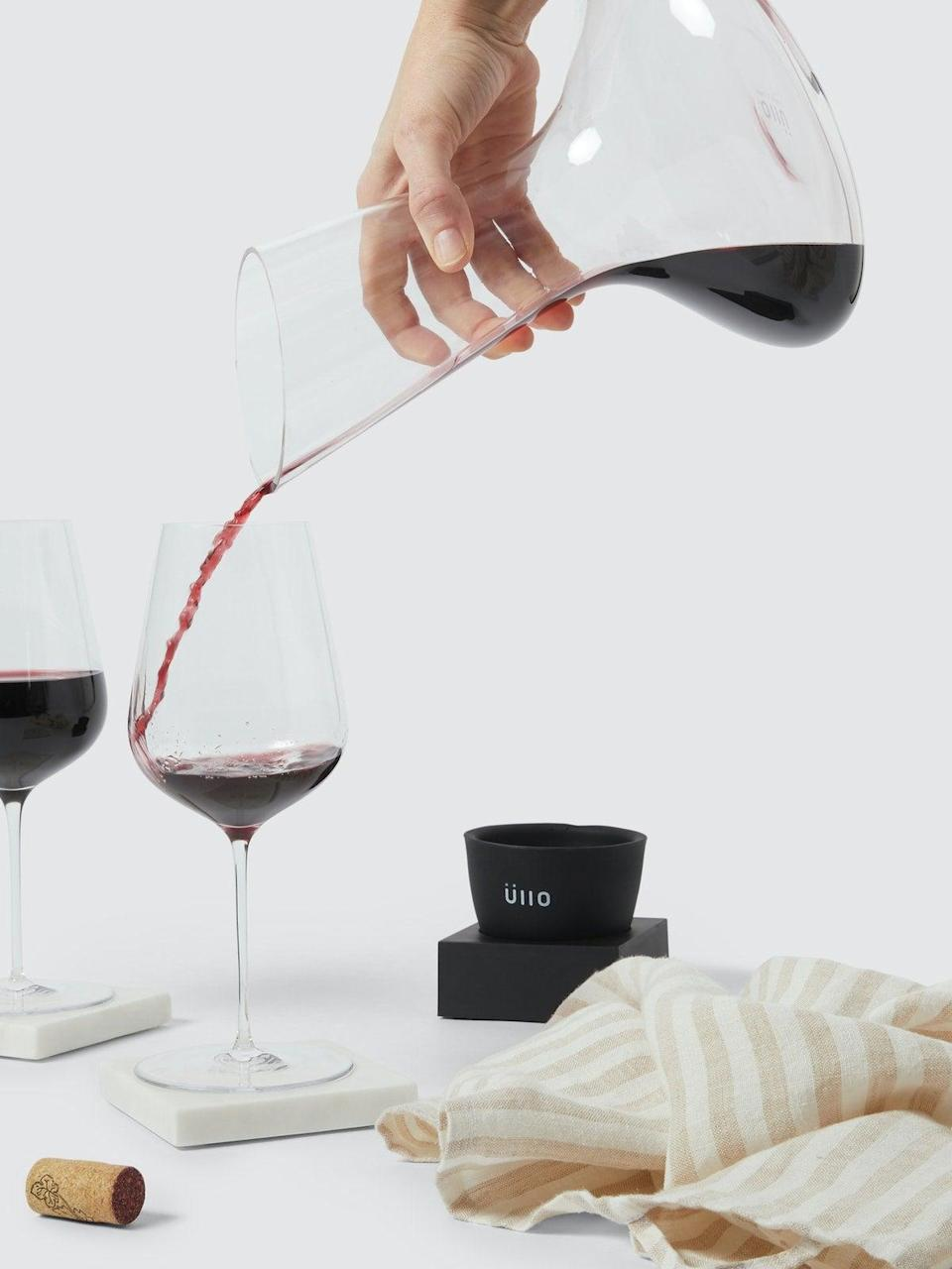 """<h2>Üllo Wine Purifier & Decanter</h2> <br>If she's real fancy-schmancy (and doesn't already own such a premium device), really wow her with Üllo's hand-blown glass decanter that pours a purified glass of sulfate-free, aroma-rich, and opened up wine — like she's dining at a 5-star restaurant, with 5-star sommelier bottle service. <br><br><em>Shop <strong><a href=""""https://www.verishop.com/brand/ullo"""" rel=""""nofollow noopener"""" target=""""_blank"""" data-ylk=""""slk:Üllo"""" class=""""link rapid-noclick-resp"""">Üllo</a></strong></em><br><br><strong>Üllo</strong> Wine Purifier & Decanter, $, available at <a href=""""https://go.skimresources.com/?id=30283X879131&url=https%3A%2F%2Fwww.verishop.com%2Fullo%2Fdecanter%2Fwine-purifier-decanter%2Fp4361131098135"""" rel=""""nofollow noopener"""" target=""""_blank"""" data-ylk=""""slk:Verishop"""" class=""""link rapid-noclick-resp"""">Verishop</a><br><br><br>"""