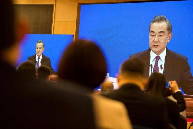 Chinese Foreign Minister Wang Yi, who will meet top US officials in Alaska, speaks at the National People's Congress in Beijing on March 7, 2021.