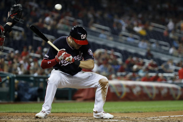 Washington Nationals' Trea Turner ducks a pitch thrown by Cincinnati Reds reliever Robert Stephenson during the eighth inning of a baseball game at Nationals Park, Tuesday, Aug. 13, 2019, in Washington. The Nationals won 3-1. (AP Photo/Alex Brandon)