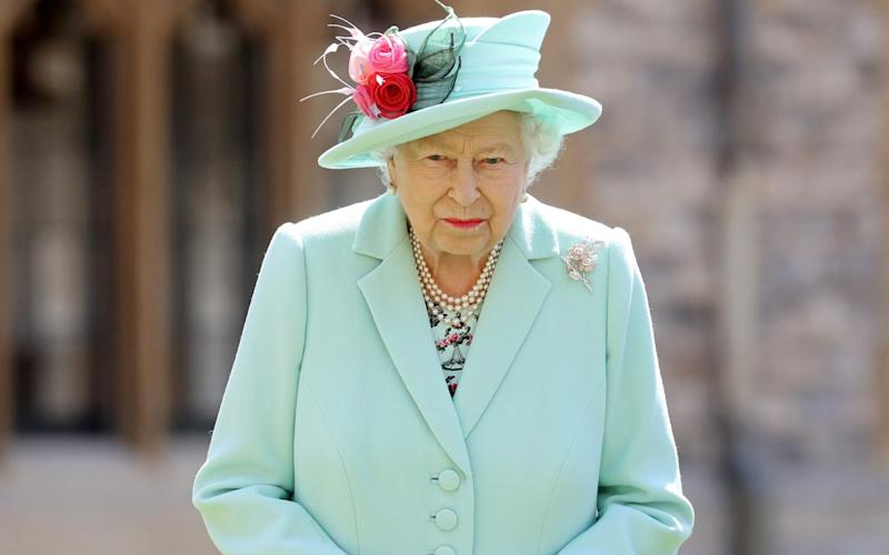 FILE PHOTO: Britain's Queen Elizabeth poses after awarding Captain Tom Moore with the insignia of Knight Bachelor at Windsor Castle, in Windsor, Britain July 17, 2020.  - Chris Jackson/REUTERS