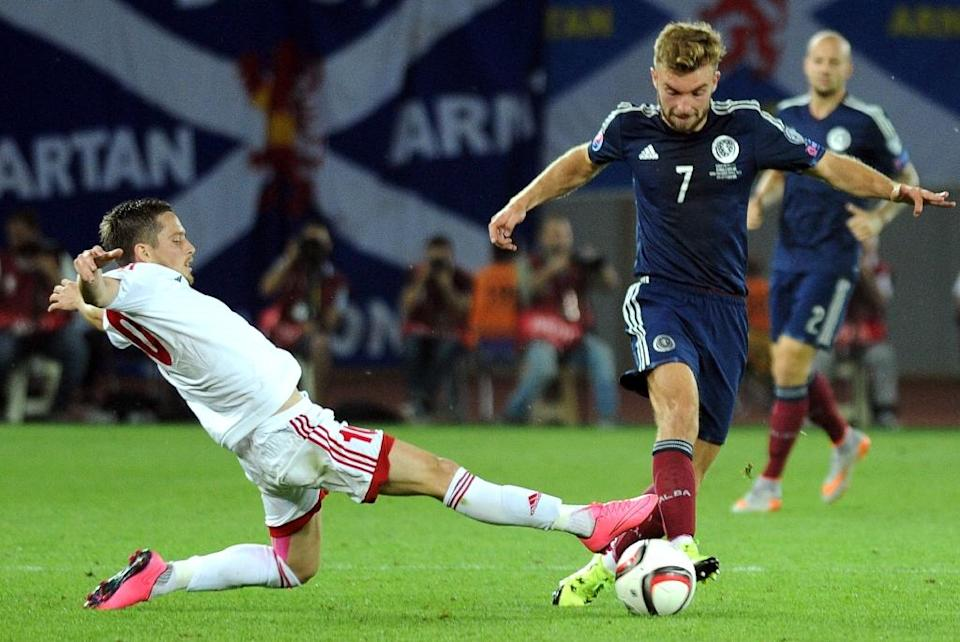 James Morrison (R) of Scotland is tackled by Jano Ananidze of Georgia during their Euro 2016 qualifying match in Tbilisi on September 4, 2015 (AFP Photo/Vano Shlamov)