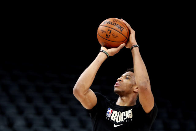 Milwaukee Bucks' Giannis Antetokounmpo shoots during a training session ahead of the NBA basketball game against Charlotte Hornets, in Paris, Thursday, Jan. 23, 2020. (AP Photo/Thibault Camus)