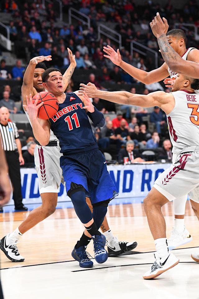 <p>Liberty forward Elijah Cuffee (10) loses the ball under pressure during the game between the Virginia Tech Hokies and the Liberty Flames in their NCAA Division I Men's Basketball Championship second round game on March 24, 2019, at SAP Center at San Jose in San Jose, CA. (Photo by Brian Rothmuller/Icon Sportswire via Getty Images) </p>